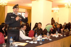 Photo of Yemeni policeman participating in workshop