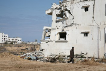 Photo of man and ruins in Gaza