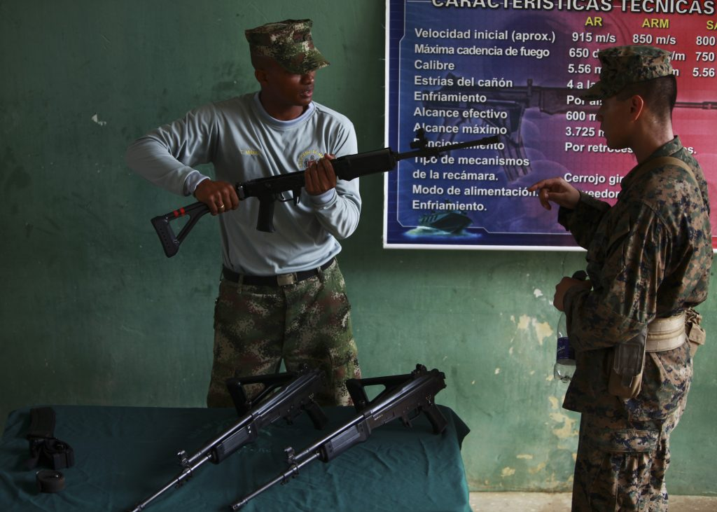 Photo of a Colombian soldier handling a rifle