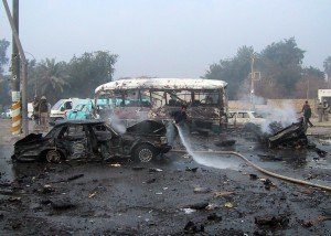 The photo showing burnt vehicles the aftermath of a car bomb in 2004, Baghdad, Iraq.