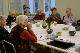 WILPF Norway members sitting listening to presentation