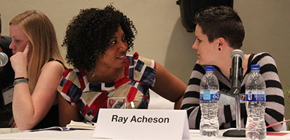 Picture of Gabriella Irsten, Joy Ada Onyesoh and Ray Acheson sitting behind a conference table.
