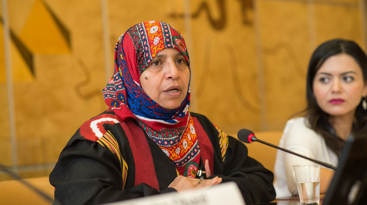 Yemeni woman speaking in a microphone