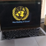 "Laptop on a desk. On the screen there is the UN logo under which is written: ""The meeting is closed""."