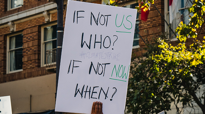 """""""If not us, who? If not now, when?"""" sign"""