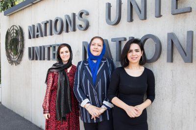 Rida Altubuly, Rawan Khalfallah and Zubaydah Albarouni standing in front of UN building