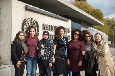 Group photo of Iraqi delegation at the CEDAW, seven women and girls standing in front of UN building
