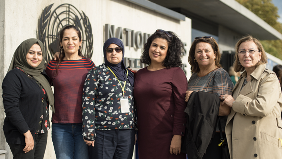 Six Irawi women standing in front of UN building