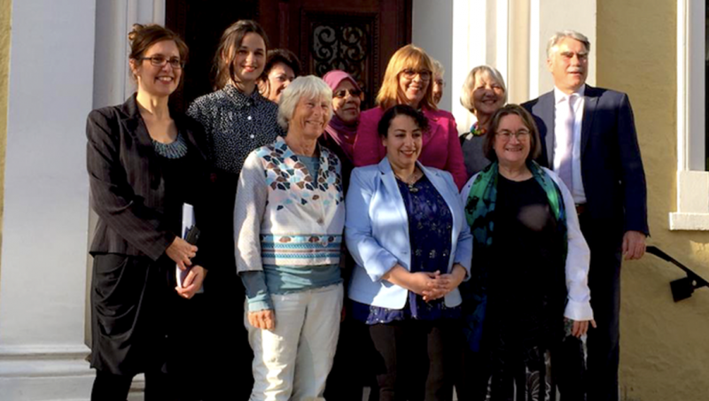 Rasha Jarhum at the centre of a group photo upon receiving Anita Augspurg Award