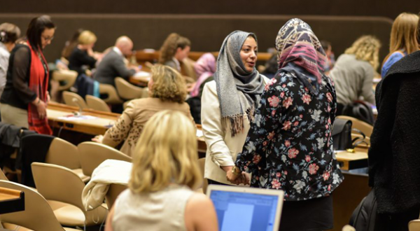Two women are greeting during WILPF MENA convening 2017