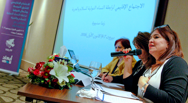 A woman is speaking in a panel during WILPF regional convening 2006