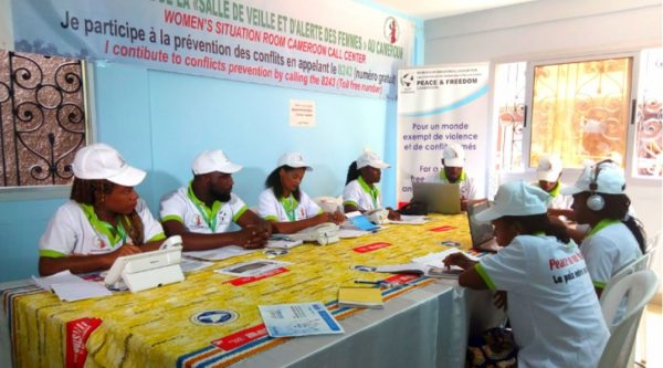 Women working at WILPF Cameroon's physical call center against electoral violence in Yaoundé